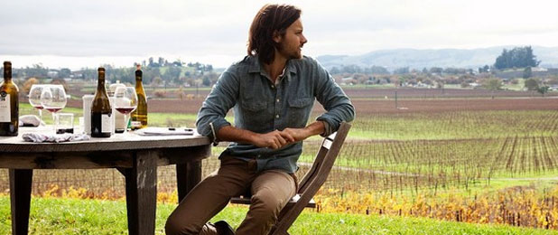 Picture of Guy Sitting in a Field Wearing a Denim Shirt
