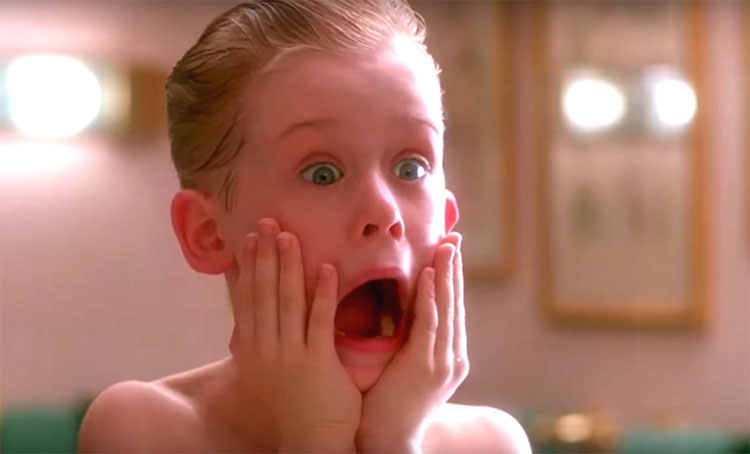 Kevin from Home Alone applying aftershave
