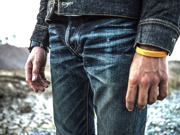 Faded raw denim jeans